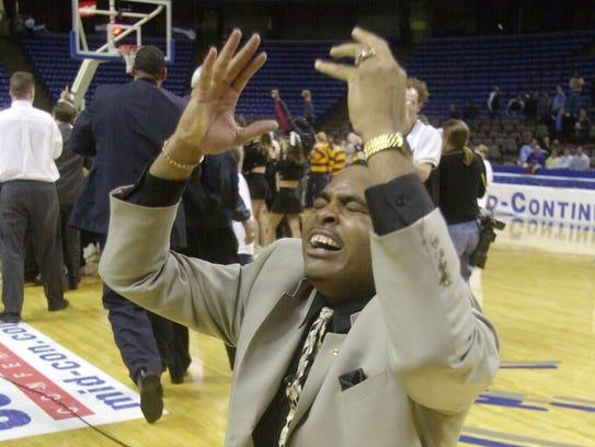 IUPUI coach Ron Hunter falls to his knees and celebrates