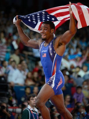 Jordan Burroughs (USA) celebrates after defeating Sadegh Saeed Goudarzi (IRI) and winning the gold in the men's freestyle 74 kg gold medal match during the London 2012 Olympic Games at ExCeL - North Arena 2.