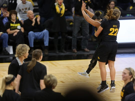 Iowa's Tania Davis, left, and Kathleen Doyle celebrate as they head into a timeout during the Hawkeyes' game against No. 13 Florida State at Carver-Hawkeye Arena on Wednesday, Nov. 29, 2017.