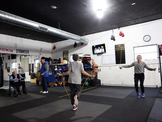 Boxing students warm up before their Rock Steady Boxing class at ICOR Boxing on Wednesday, Nov. 29, 2017. The class helps clients with Parkinson's Disease address symptoms with strength and agility exercises.