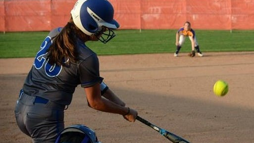 Evangel's Claire McMillan takes a swing in a recent game.
