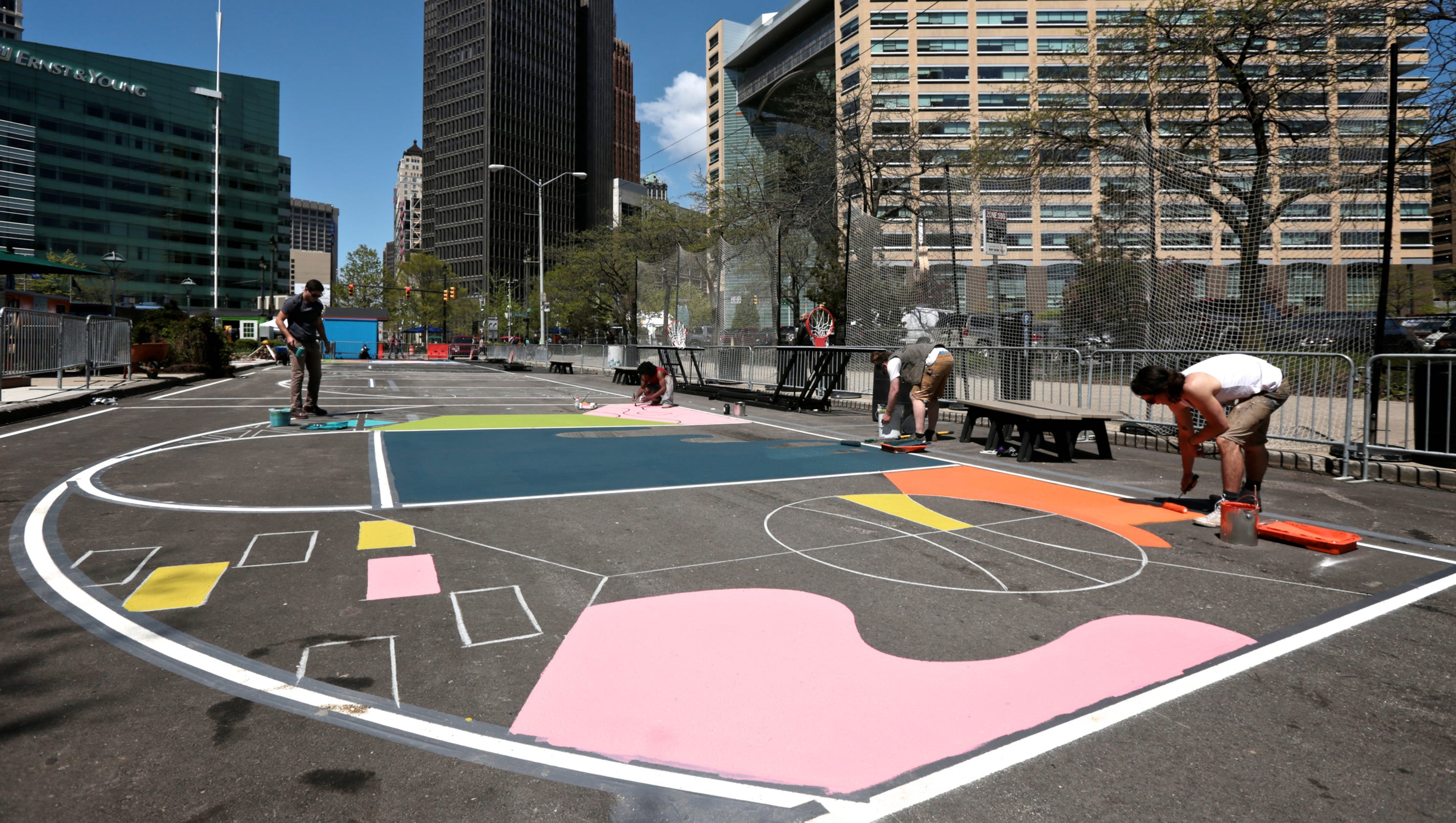 Photos artist paints cadillac square basketball courts for Basketball mural