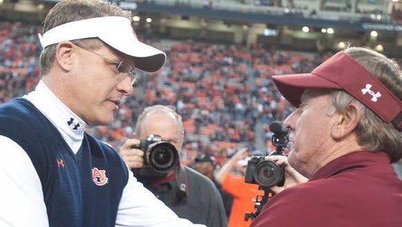 Auburn coach Gus Malzahn greets South Carolina coach