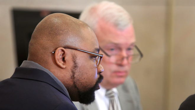 Glen Bates (left) is shown with his attorney, Rich Wendel ll, during his jury trial.