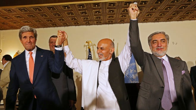 From left, Secretary of State John Kerry, Afghanistan's presidential candidate  Ashraf Ghani Ahmadzai, and Afghan presidential candidate Abdullah Abdullah during  a joint news conference in Kabul, Afghanistan. The Obama administration on Thursday stepped up efforts to press Afghanistan's two feuding presidential candidates to end their dispute over June elections, accept the results of an ongoing audit of all ballots and form a national unity government by early September. On an unannounced visit to Kabul, Kerry made personal appeals to both candidates _ former Foreign Minister Abdullah Abdullah and former Finance Minister Ashraf Ghani Ahmadzai _ to understand the urgency of finding a resolution before the upcoming NATO summit in Wales on September 4, according to officials traveling with Kerry. (AP Photo/Rahmat Gul, File)