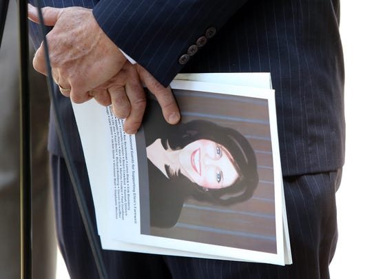 Alan Brody holds a picture of his wife, Ellen Brody,