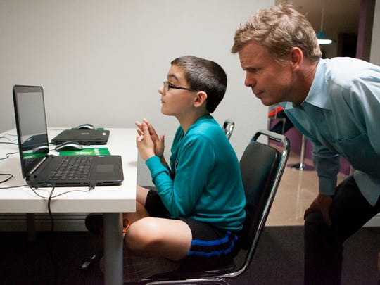 Anthony Dhondt, 9, learns how to code a game of Minecraft