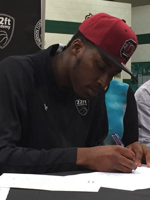 Seedee Keitha of 22 Feet Academy of Shannon Forest Christian School, signs Nov. 11, 2015, to play basketball at the University of South Carolina.
