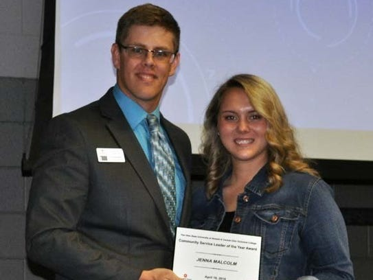 Jenna Malcolm, right, is honored for her work.