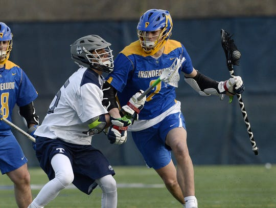 Irondequoit's Jack Brennan, right, is defended by Webster