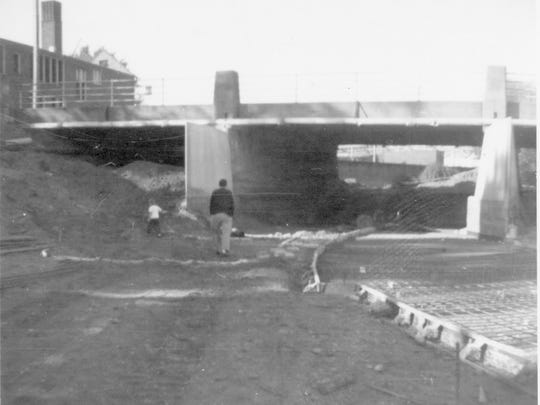 Historian Kurt Thornton with his father in 1960, exploring construction of the river diversion that was part of Battle Creek's   flood control plan.