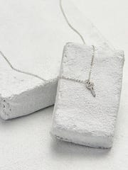 The Mini Key Chain necklace can be engraved with Hope,