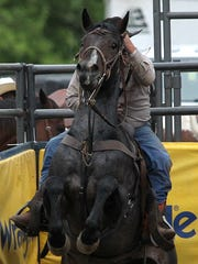 A competitor and his horse get ready to spring into action during the steer wrestling competition Saturday, June 7, at the Wisconsin River Pro Rodeo in Merrill at the Lincoln County Fairgrounds in 2014,