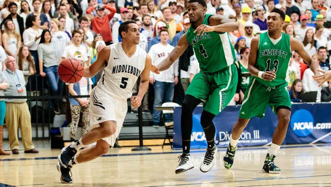 Middlebury senior guard Jake Brown, left, drives baseline against Endicott's Daquan Sampson during the first half of Friday night's NCAA Sweet 16 game at Middlebury College's Pepin Gym. The Panthers won 89-60.