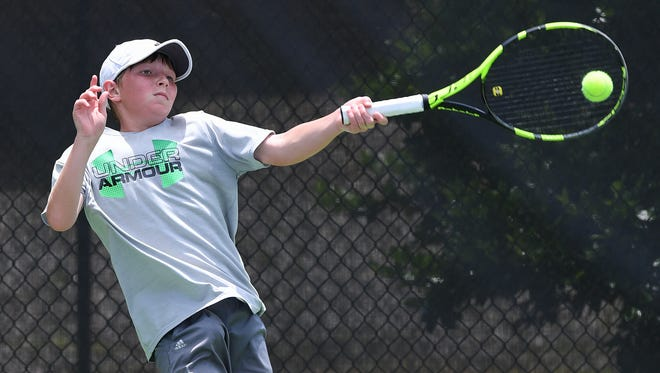 Matthew Rundle returns the ball while playing Matthew Pitts in the Boys 14s semifinals during the Palmetto Championships in Belton on Monday, May 29, 2017. Rundle won 6-3, 6-2 to advance to finals on Tuesday.