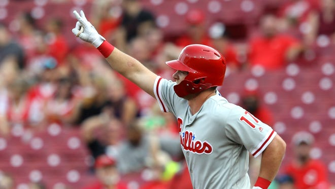 Philadelphia Phillies left fielder Rhys Hoskins (17) reacts after hitting a home run against the Cincinnati Reds in the first inning at Great American Ball Park.