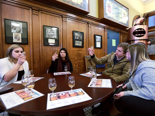 From left, Josee Khoury, Julie Clark, Daniel Todhunter and Selena Santia sample whiskey during a tour of the Canadian Club Brand Centre in Windsor, Ontario on Friday, February 10, 2017.