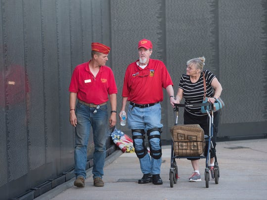 Lenny Collins, center, and his wife, Gloria, right, talk Thursday, May 25, 2017, with fellow Marine Corps League member Cliff Zack as the three visit the Wall South at Veterans Memorial Park in Pensacola.
