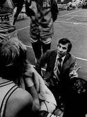 Coach Mauro Penaggio talks to members of the Rochester Zeniths basketball team during a break between the first and second quarters in a December 1981 game.