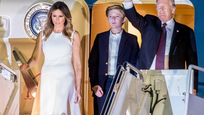 President Donald Trump, first lady Melania, and his son Barron arrive on Air Force One at Palm Beach International Airport on Tuesday.