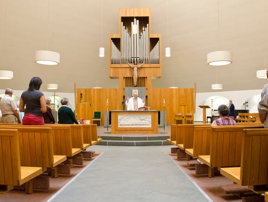Parishioners attend a mass at the Cathedral of the