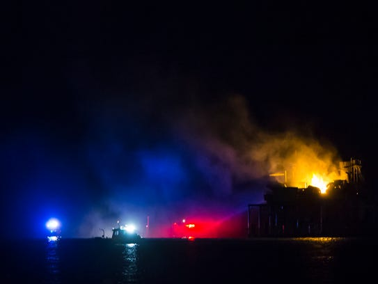 Rescue boats surround a rig in Lake Pontchartrain near