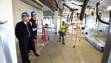Tweet/Garot Chairman Tim Howald and CEO Christopher Howald check the progress of the company's renovation of its new headquarters building at 325 Reid St. in De Pere.