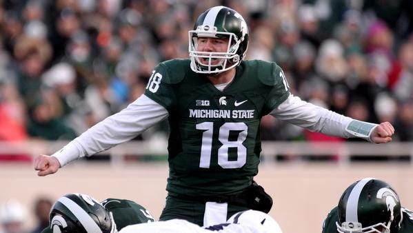 Connor Cook gets the offense lined up before a play during MSU's 55-16 win over Penn State Saturday at Spartan Stadium in East Lansing.