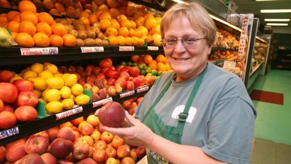 Linda Concklin Hill holds one of the farms' Winesap apples for sale in the store at The Orchards of Concklin in Ramapo, in this May 11, 2012, photo. The working farm was celebrating its 300th anniversary that year.