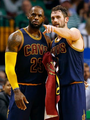 Kevin Love talks with LeBron James during the second half against the Boston Celtics.