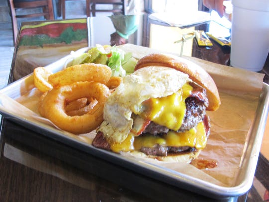 Jimmy's P's Burgers & More, which recently opened in North Naples, specializes in craft burgers, including The Hangover Burger, which includes two 5-ounce Wagyu patties, pastrami, a fried egg, bacon and cheddar on a brioche bun.
