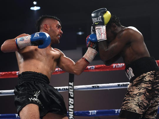 """Reno's Santos Vasquez, left, takes on Anthony Taylor  during the Top Rank """"Cinco de Mayo"""" boxing event at the Reno/Sparks Convention Center in Reno on May 5, 2017. Vasquez won the fight by TKO."""