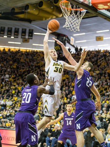 Iowa senior Aaron White (30) drives to the basket through