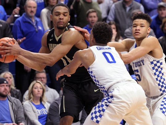 Vanderbilt's Jeff Roberson looks for an opening as Kentucky's Quade Green, foreground, and Kevin Knox defend during the second half of an NCAA college basketball game Tuesday, Jan. 30, 2018, in Lexington, Ky. Kentucky won in overtime,p 83-81. (AP Photo/James Crisp)
