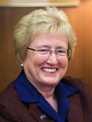 Henry Ford Health System CEO Nancy Schlichting, who recently announced she will retire in 2016, poses for a photo at the Henry Ford Corporate Headquarters in Detroit Jan. 8, 2015.
