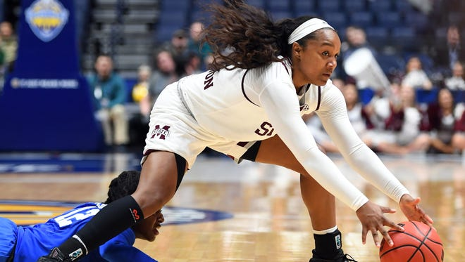 Mississippi State Lady Bulldogs guard Roshunda Johnson (11) controls the ball against Kentucky Wildcats guard Amanda Paschal (12) during the first half of the SEC Conference Tournament at Bridgestone Arena. Mandatory Credit: Christopher Hanewinckel-USA TODAY Sports