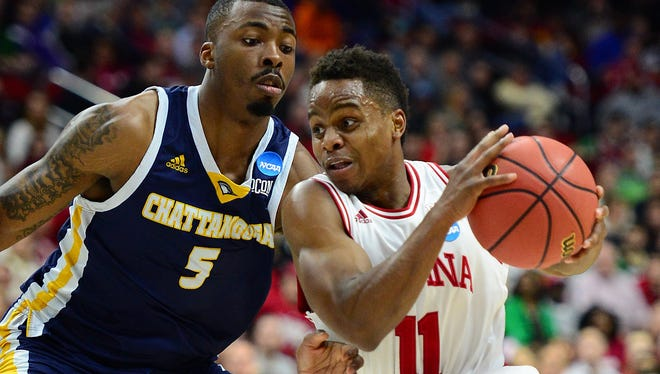 Indiana Hoosiers guard Yogi Ferrell (11) drives to the basket against Chattanooga Mocs forward Justin Tuoyo (5) during the first half in the first round of the 2016 NCAA Tournament at Wells Fargo Arena.