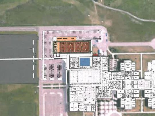 Sauk Rapids field house Option 4, which would contain four basketball courts and no track. The facility would also include a corridor connecting to the high school. The cost is estimated at $9 million.