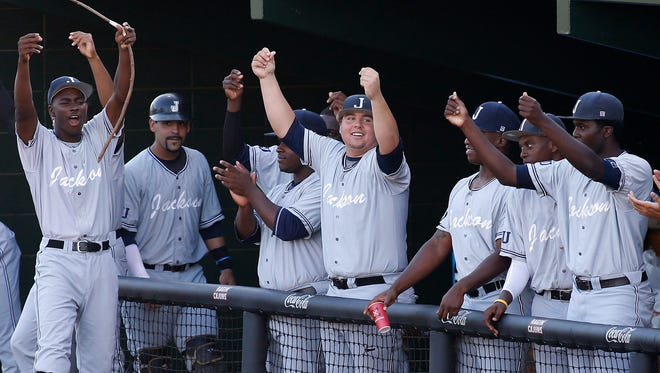 Jackson State's dugout celebrates after teammate Desmond Russell (not shown) scored the team's only run in the fourth inning during an NCAA college baseball tournament regional game against Louisiana-Lafayette in Lafayette, La., Friday, May 30, 2014. Jackson State won 1-0.
