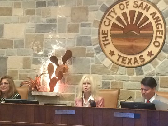 Brenda Gunter, San Angelo's first female mayor, takes her seat on council after being sworn in Tuesday, May 16.