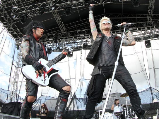 Nikki Sixx, left, and lead singer James Michael, of Sixx:A.M., perform during Fort Rock 2016 at JetBlue Park. Nikki Sixx is best known for his work with Motley Crue.