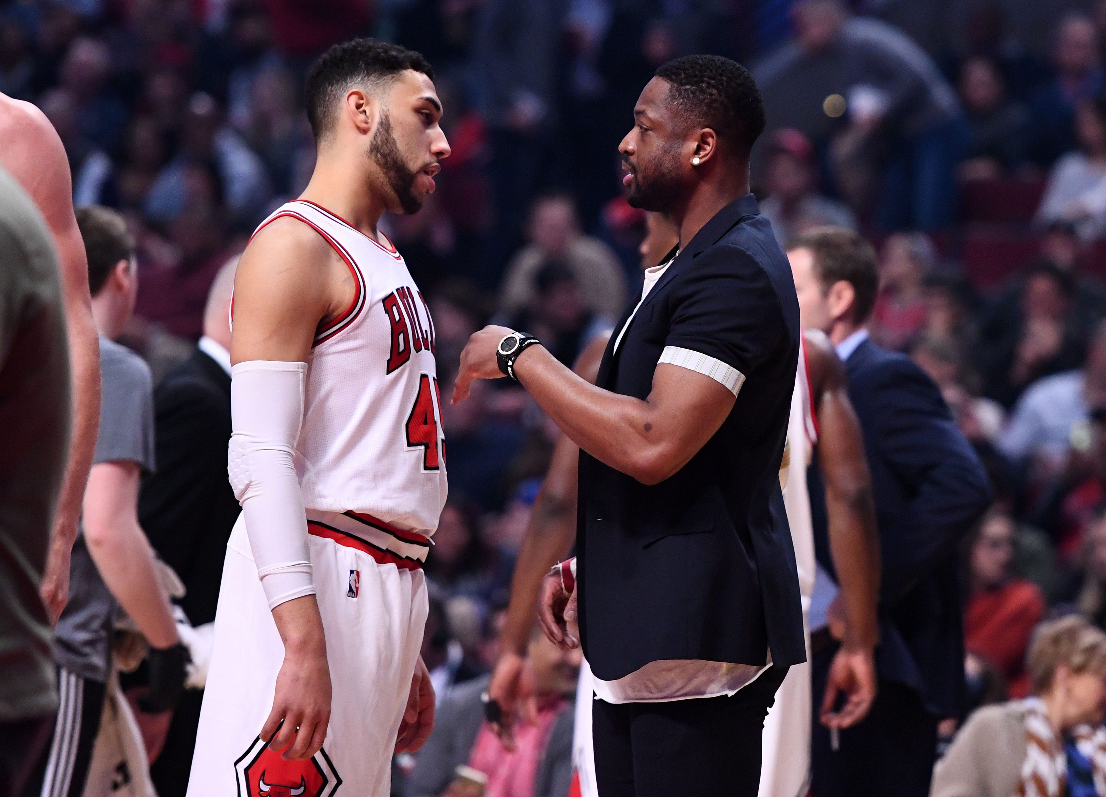 Denzel Valentine, Left, Listens To Chicago Bulls Teammate Dwyane Wade  (right) ) During A Time Out In A Game Against The Utah Jazz On March. 18.