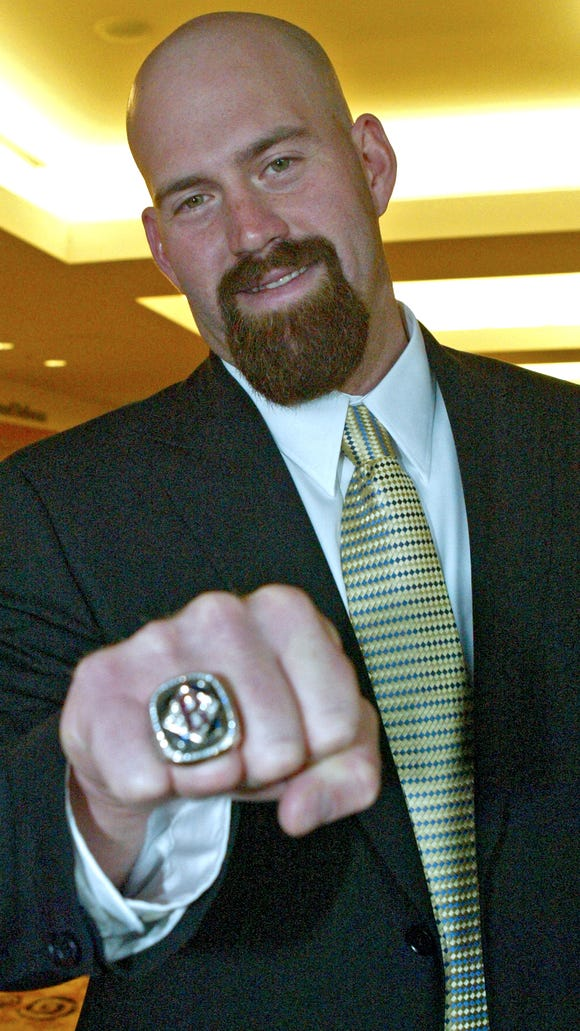 Kevin Youkilis shows a World Series ring he won with the Red Sox during a visit to Cincinnati in 2007.