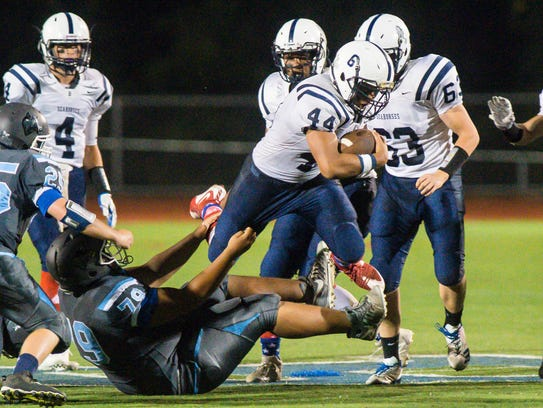 Burlington's Manny Dodson leaps over South Burlington's