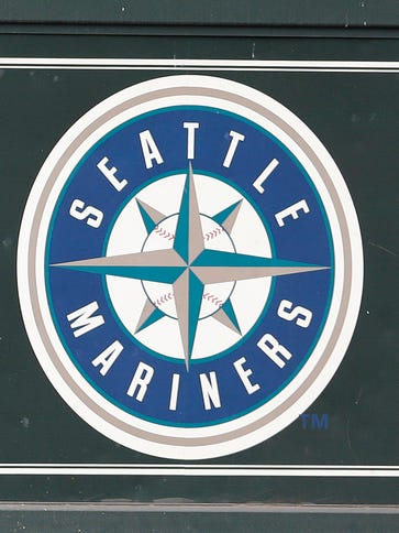 The Mariners logo is seen on a scoreboard in Safeco