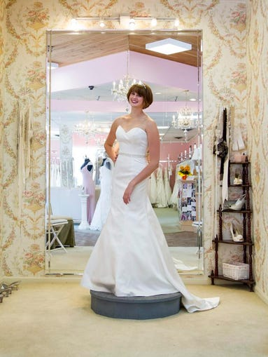 Scout Hardin models wedding dresses at the Bridal Suite of Louisville. June 18, 2014.