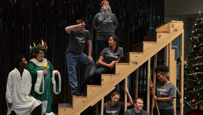 "The cast of MSU's production of ""A Christmas Carol"" rehearses a scene from the holiday classic. The university's rendition, which opened Nov. 17, uses a play-within-a-play adaptation by James Reynard."