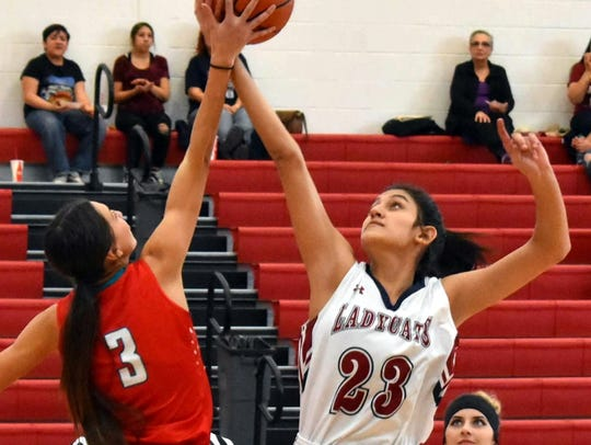 Junior 6-foot-1 post Vanessa Garcia (23) led the lady