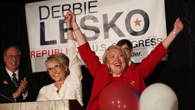 Gov. Jan Brewer (left) celebrates with Republican congressional candidate Debbie Lesko during an election night party in Peoria, Ariz. April 24, 2018. Lesko won a special election against Democrat Hiral Tipirneni for the 8th Congressional District seat vacated by disgraced former Rep. Trent Franks.