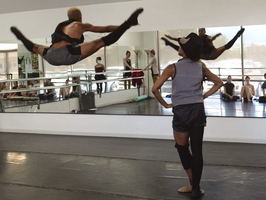Amir Yorke (left) and Courtney Cochran rehearse for